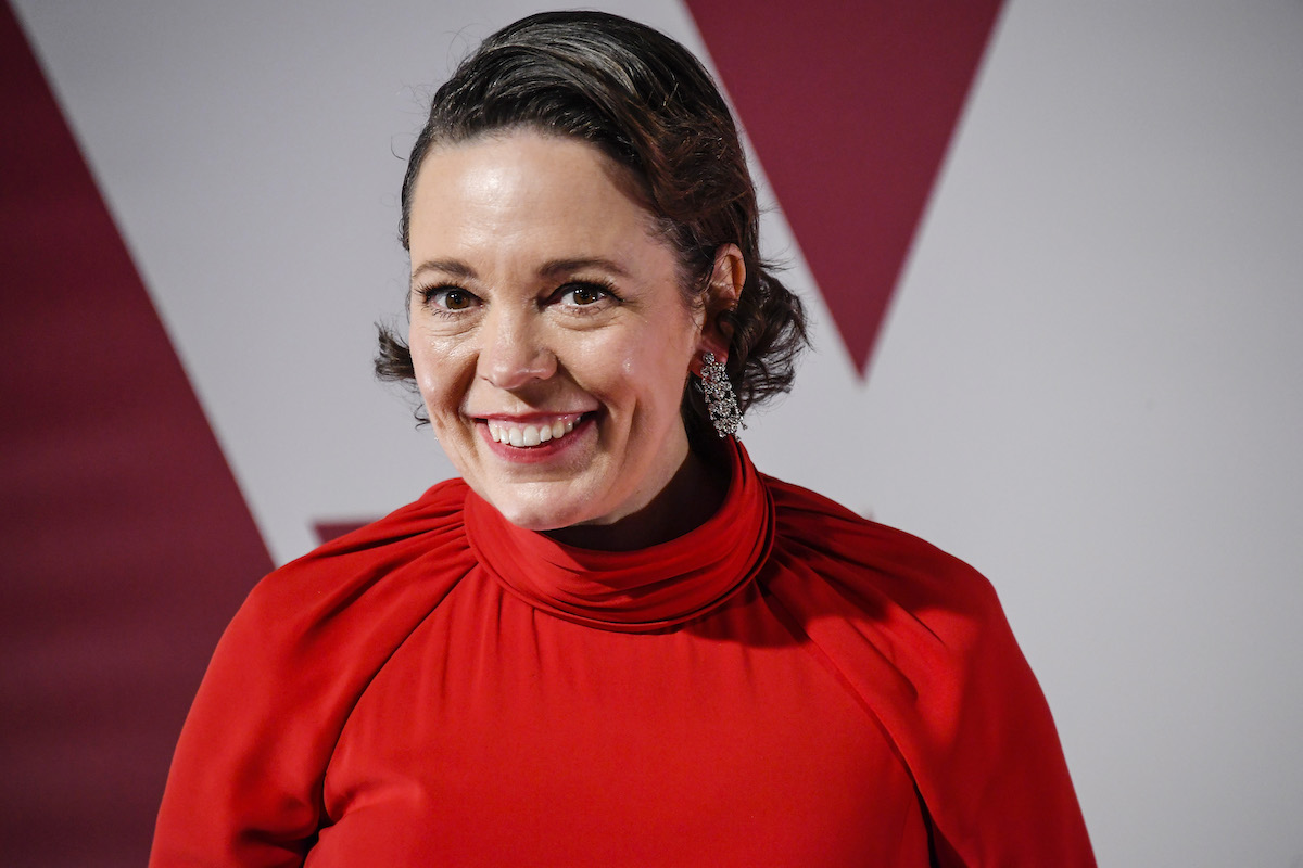 Olivia Colman on the red carpet in a red dress