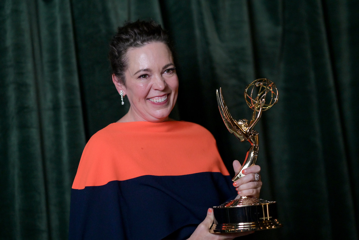 Olivia Colman smiles as she holds her trophy at the 2021 Emmy Awards