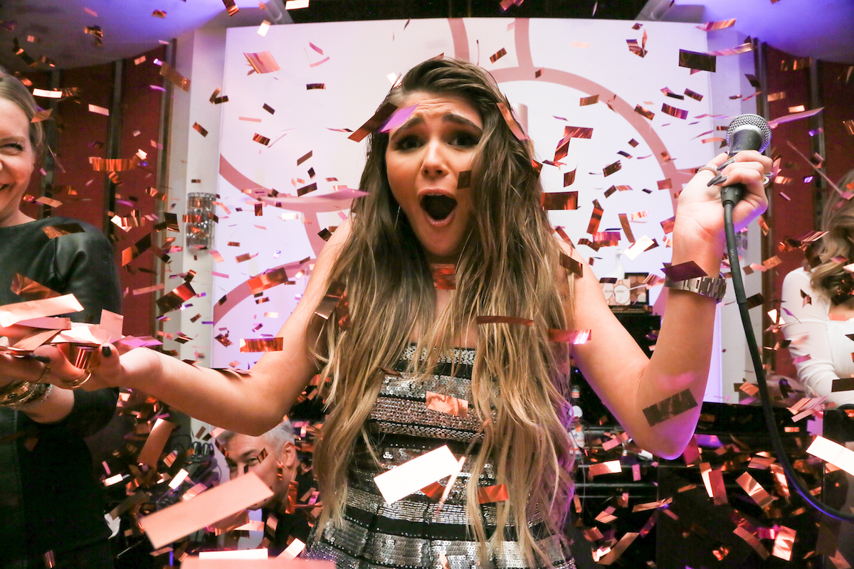 Confetti falls on Olivia Jade Giannulli at the launch of her Sephora collection in  December 2018