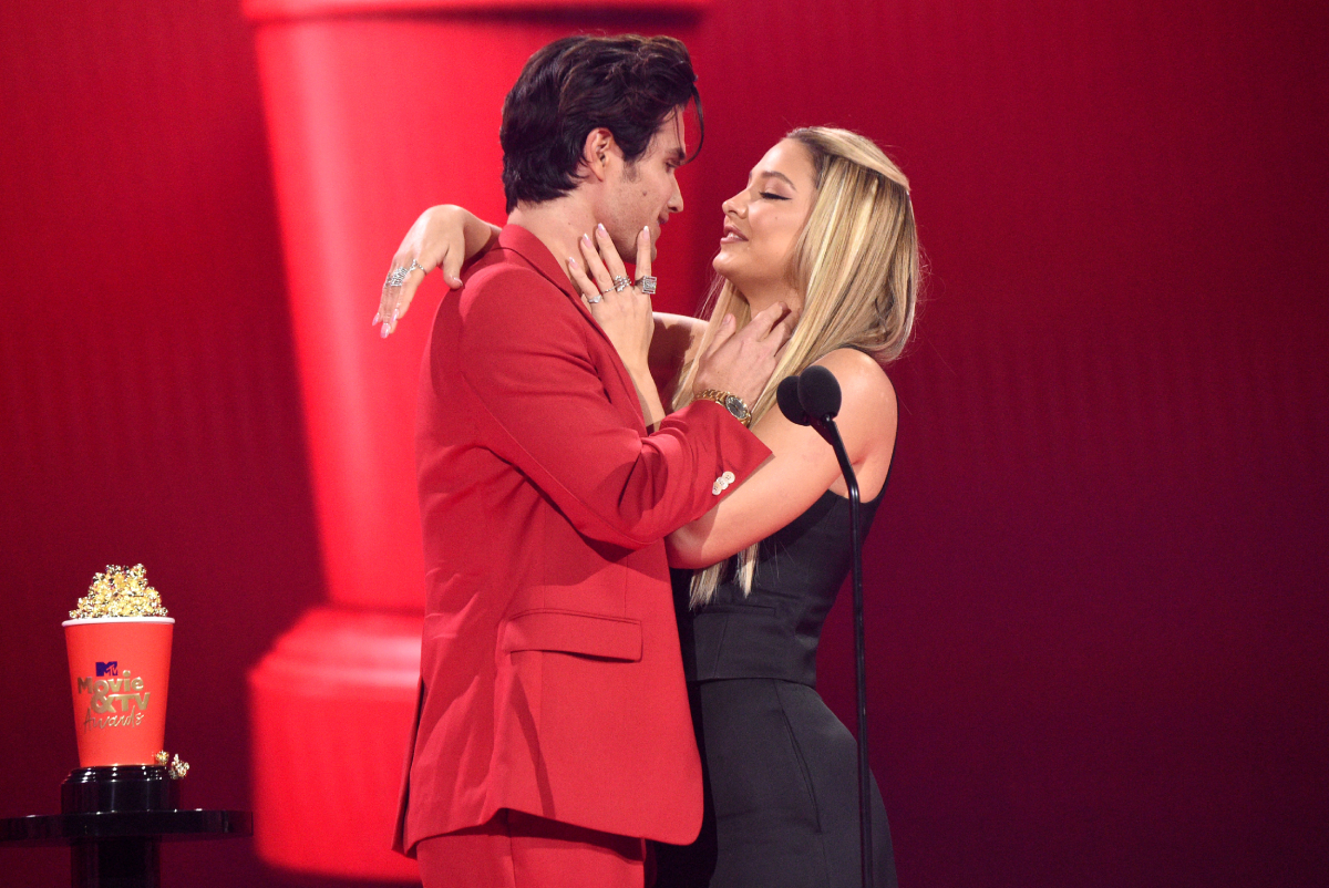 Chase Stokes and Madelyn Cline accept the Best Kiss award for 'Outer Banks' onstage during the 2021 MTV Movie & TV Awards at the Hollywood Palladium on May 16, 2021 in Los Angeles, California