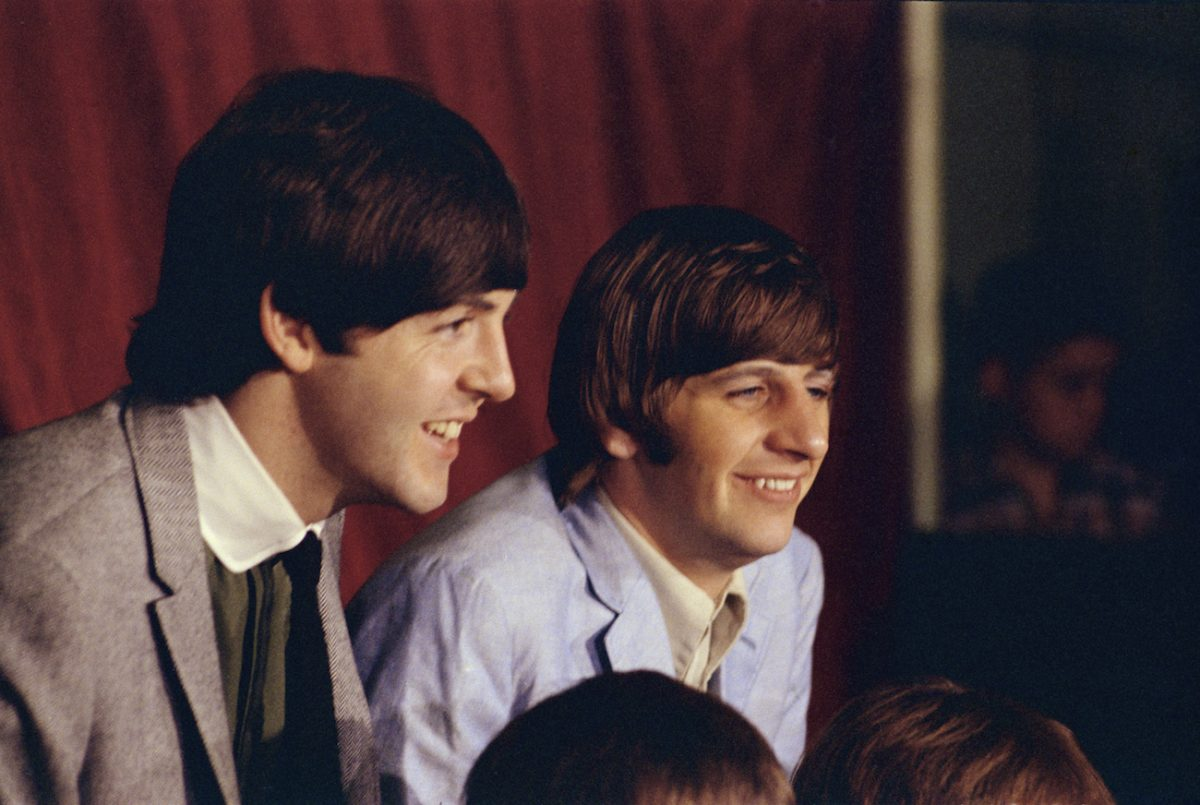 Paul McCartney and Ringo Starr laughing in 1965.