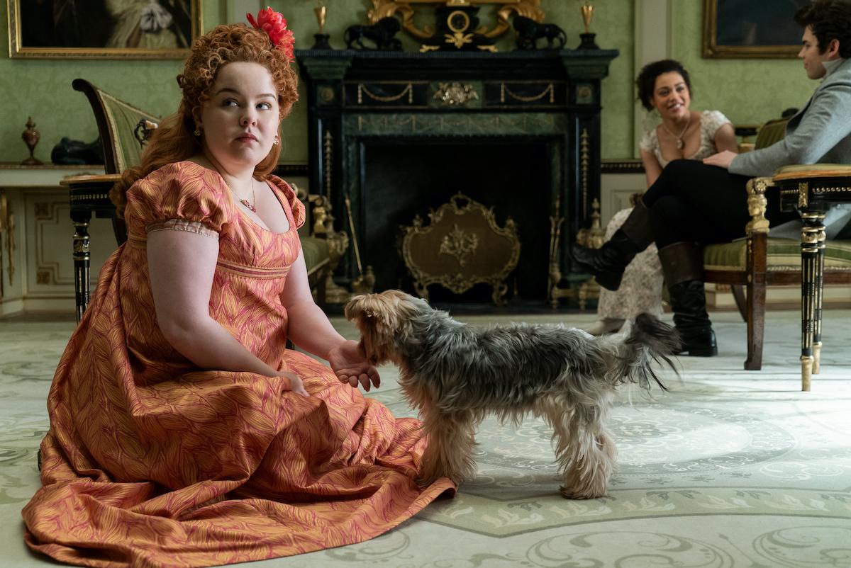 NICOLA COUGHLAN as PENELOPE FEATHERINGTON, RUBY BARKER as MARINA THOMPSON and LUKE NEWTON as COLIN BRIDGERTON in episode 101 of BRIDGERTON