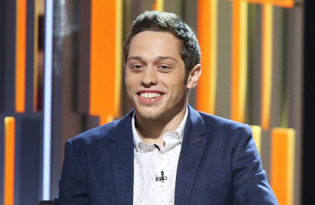Pete Davison smiling in front of a multicolor background