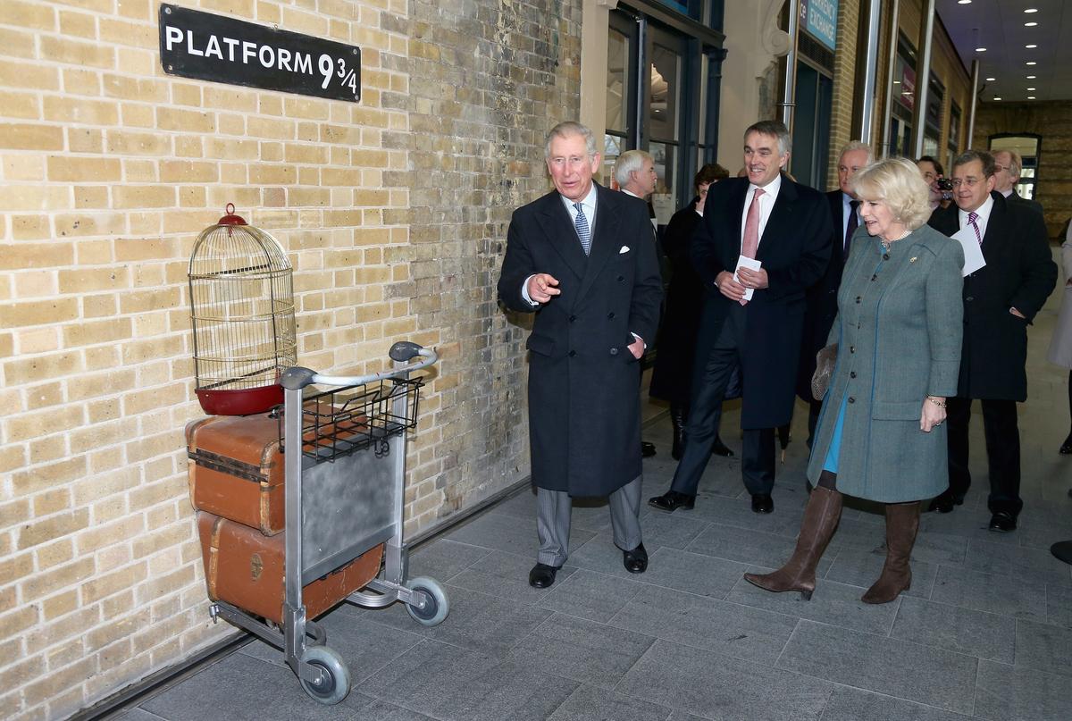 Prince Charles, Prince of Wales and Camilla, Duchess of Cornwall visit platform 9 3/4 at King's Cross Rail Station