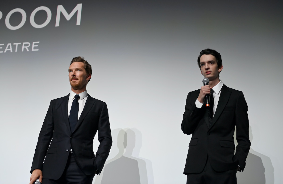 Benedict Cumberbatch (L) and Kodi Smit-McPhee speak onstage during Netflix's 'Power Of The Dog' screening during the Toronto International Film Festival at the Princess of Wales Theatre on September 10, 2021 in Toronto, Ontario. They recently chatted about the differences between superhero and novel adaptations
