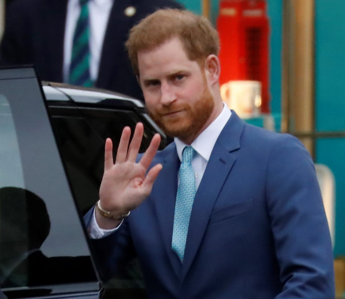 Prince Harry waving goodbye as he leaves the annual Commonwealth Service at Westminster Abbey