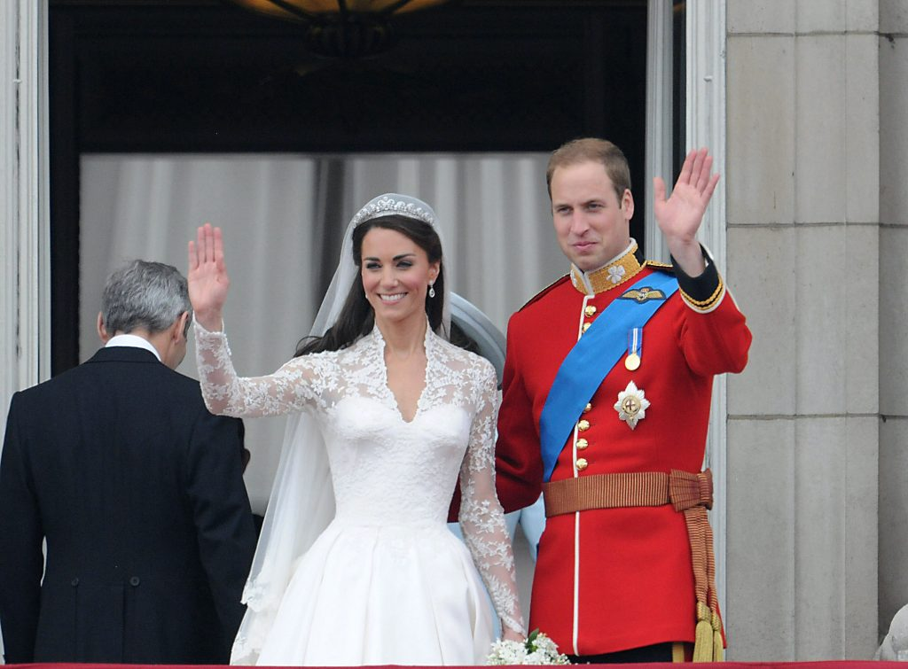 William and Kate wedding day photo showing Catherine, Duchess of Cambridge and Prince William waving from a balcony
