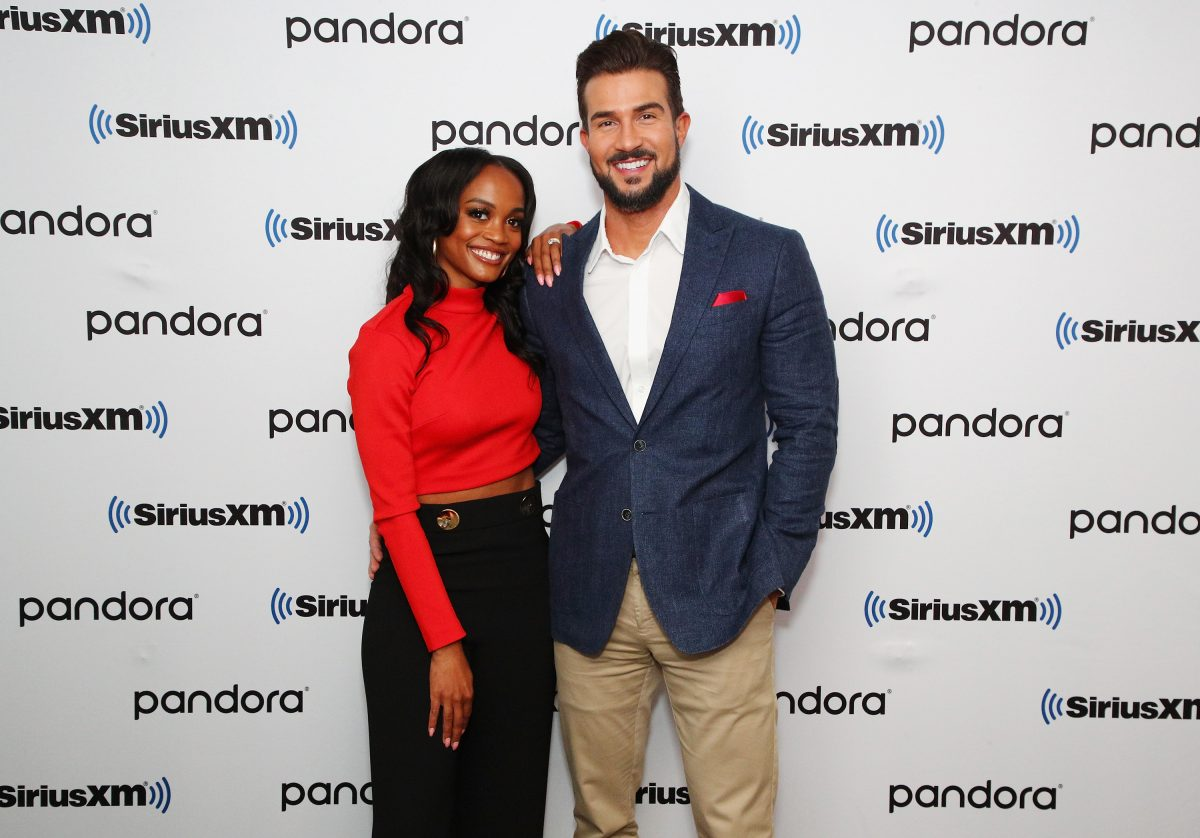Rachel Lindsay in a red sweater and Bryan Abasolo in a blue suit.
