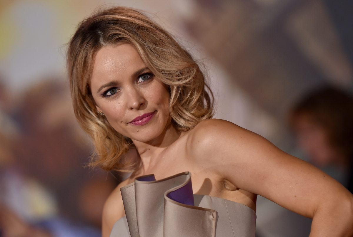Rachel McAdams on the red carpet. She's wearing a strapless golden dress that ruffles at the top. Her blonde hair is curled at the ends.