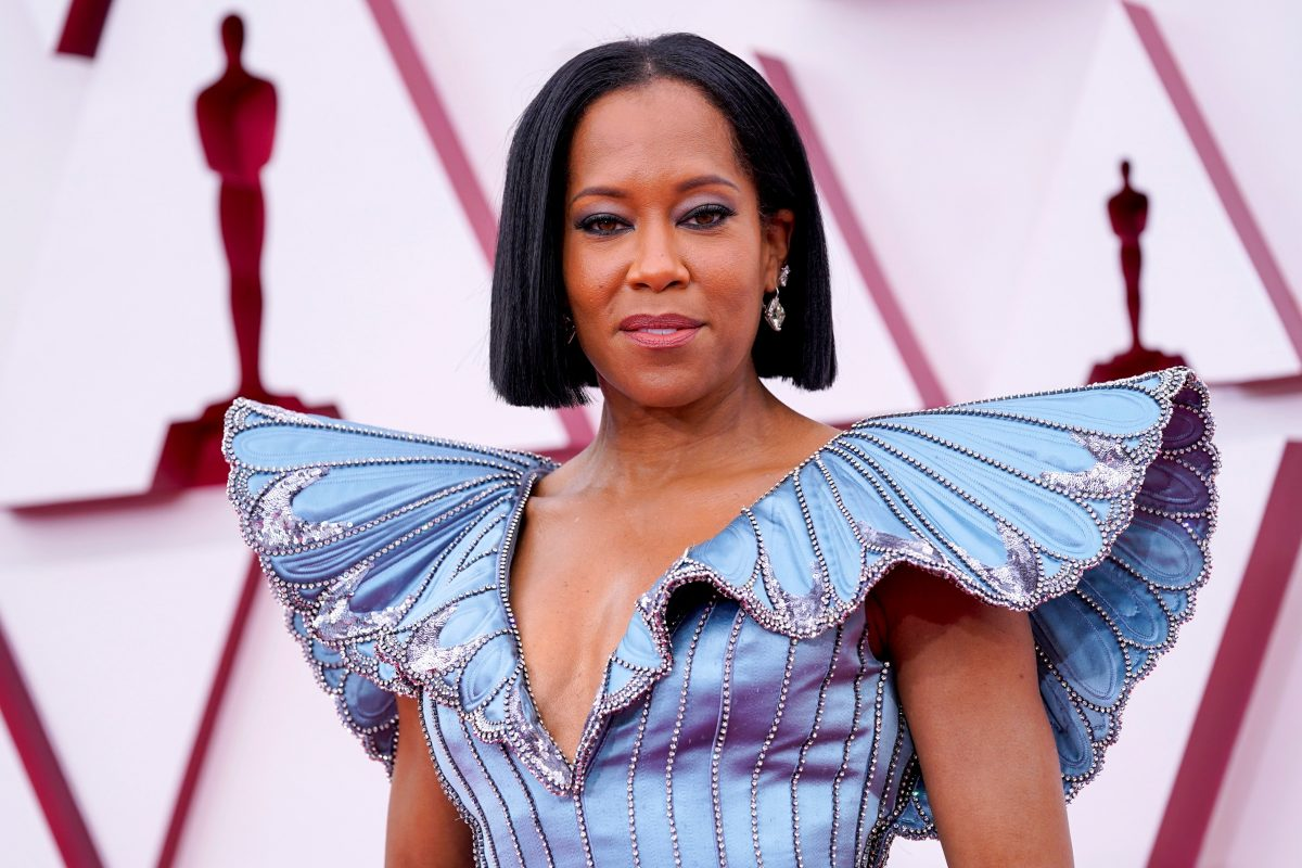 Regina King posing in a blue gown at Academy Awards in 2021.