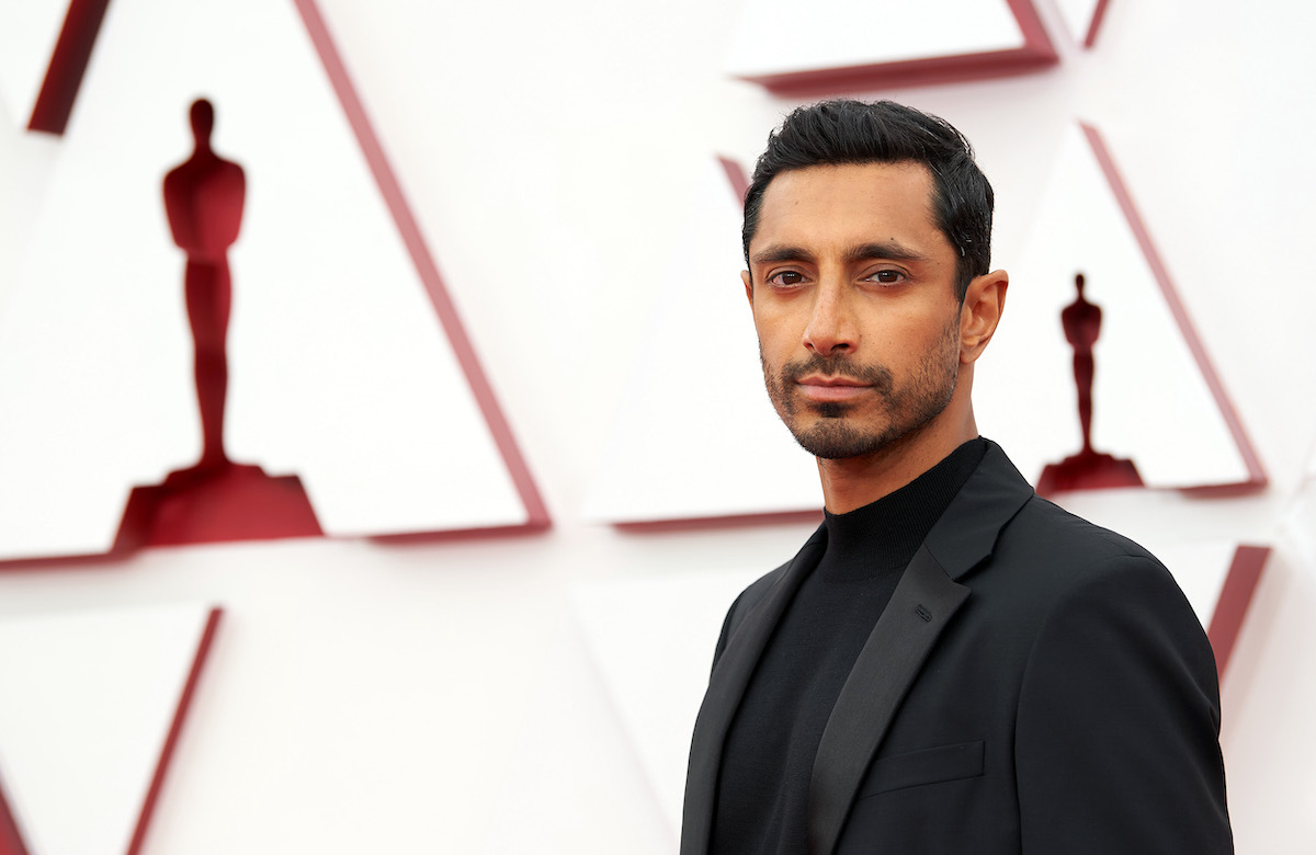 Riz Ahmed in a black suit on the red carpet