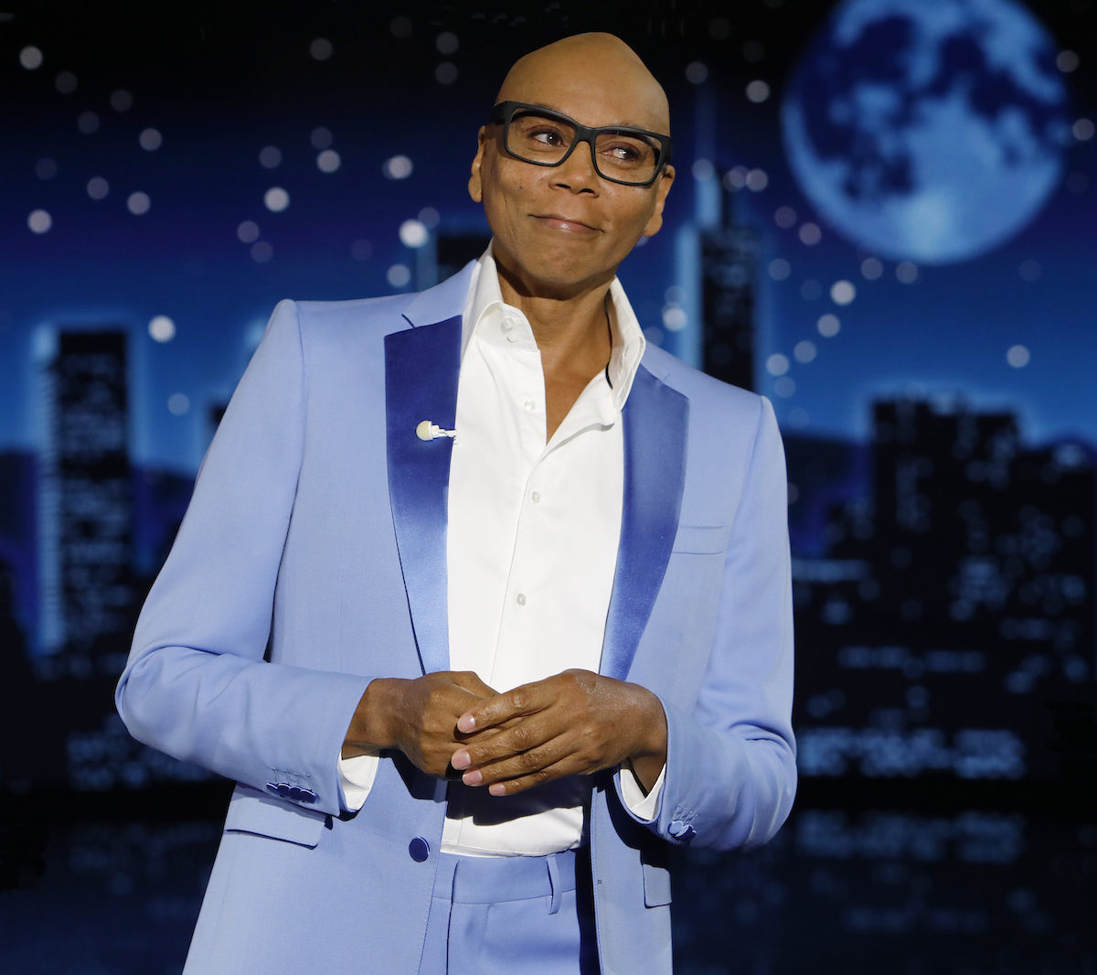 """RuPaul smiling on stage wearing a blue suit at """"Jimmy Kimmel Live!"""""""