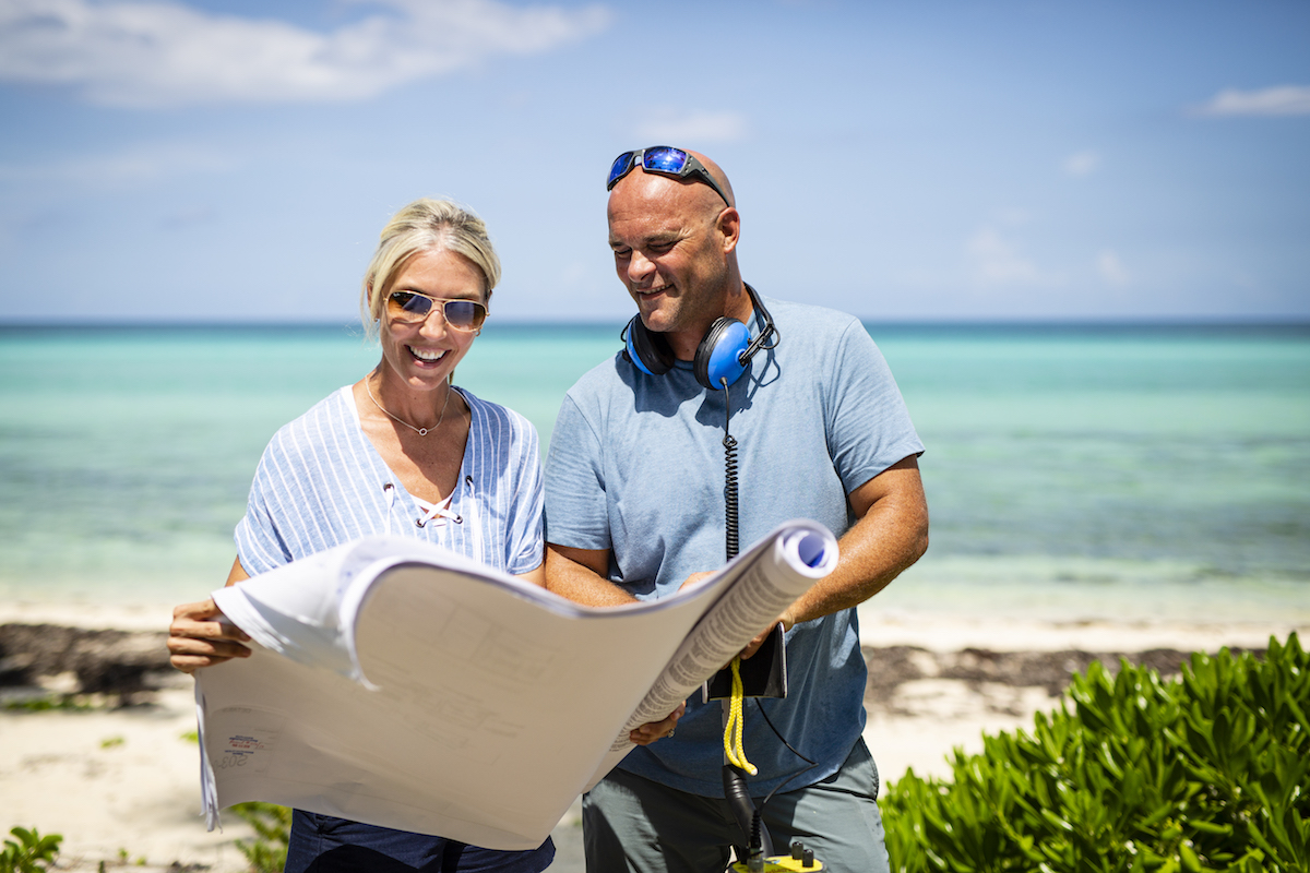 Sarah and Bryan look over plans on 'Renovation Island'