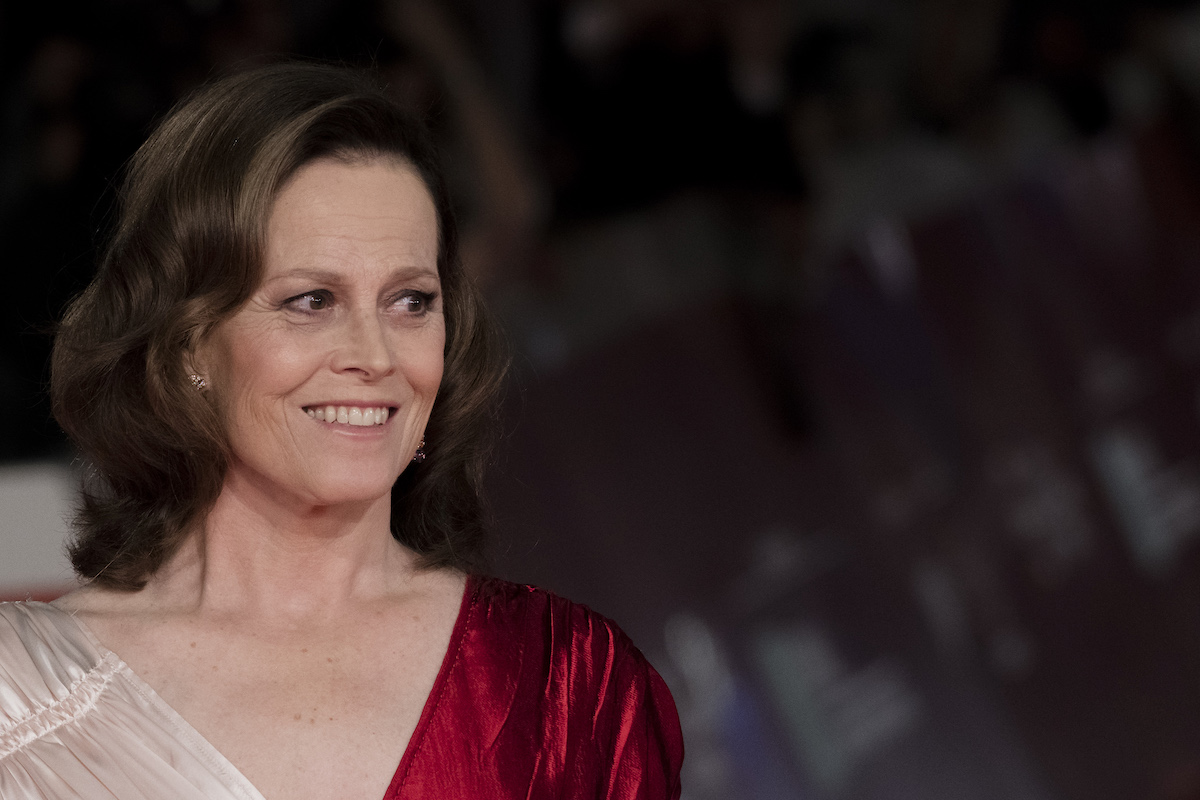 Sigourney Weaver of 'Ghostbusters' in a red and cream dress