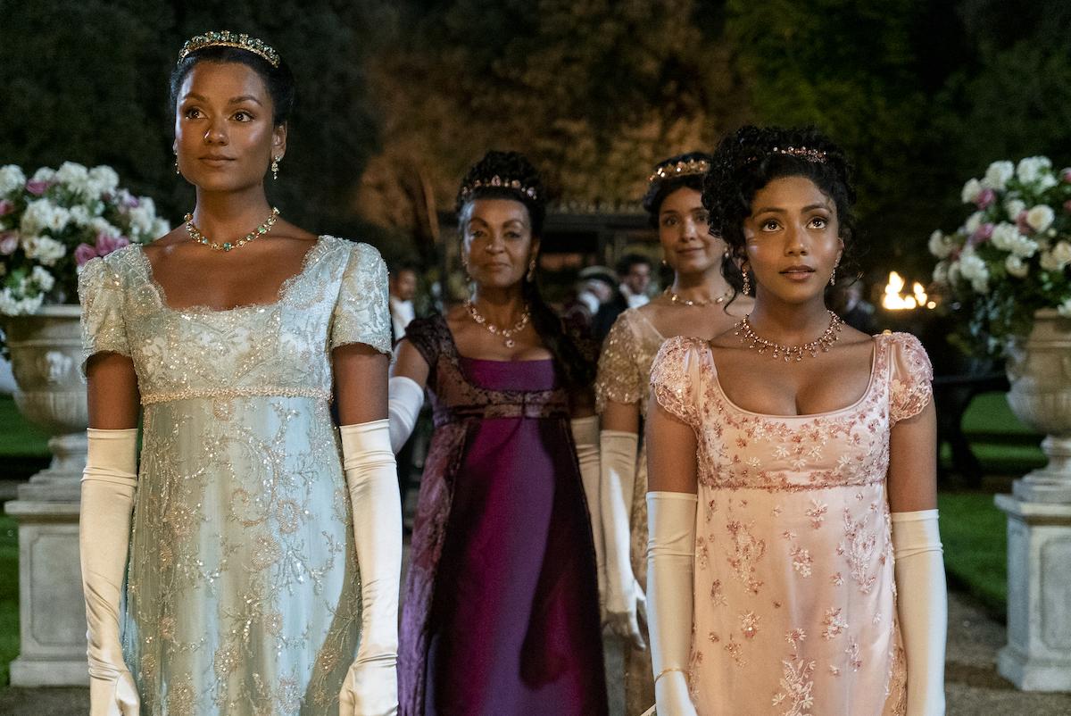 Simone Ashley, Adjoa Andoh, Shelley Conn, and Charithra Chandran wearing dresses to a ball in 'Bridgerton' Season 2.