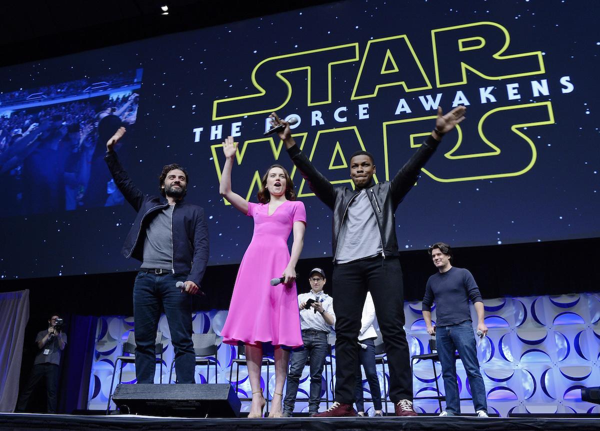 Cast members (L -R) Oscar Isaac, Daisy Ridley, John Boyega of 'Star Wars: The Force Awakens.'
