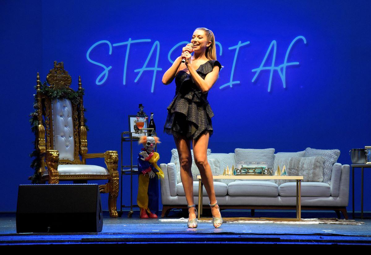 Stassi Schroeder in a black dress on stage