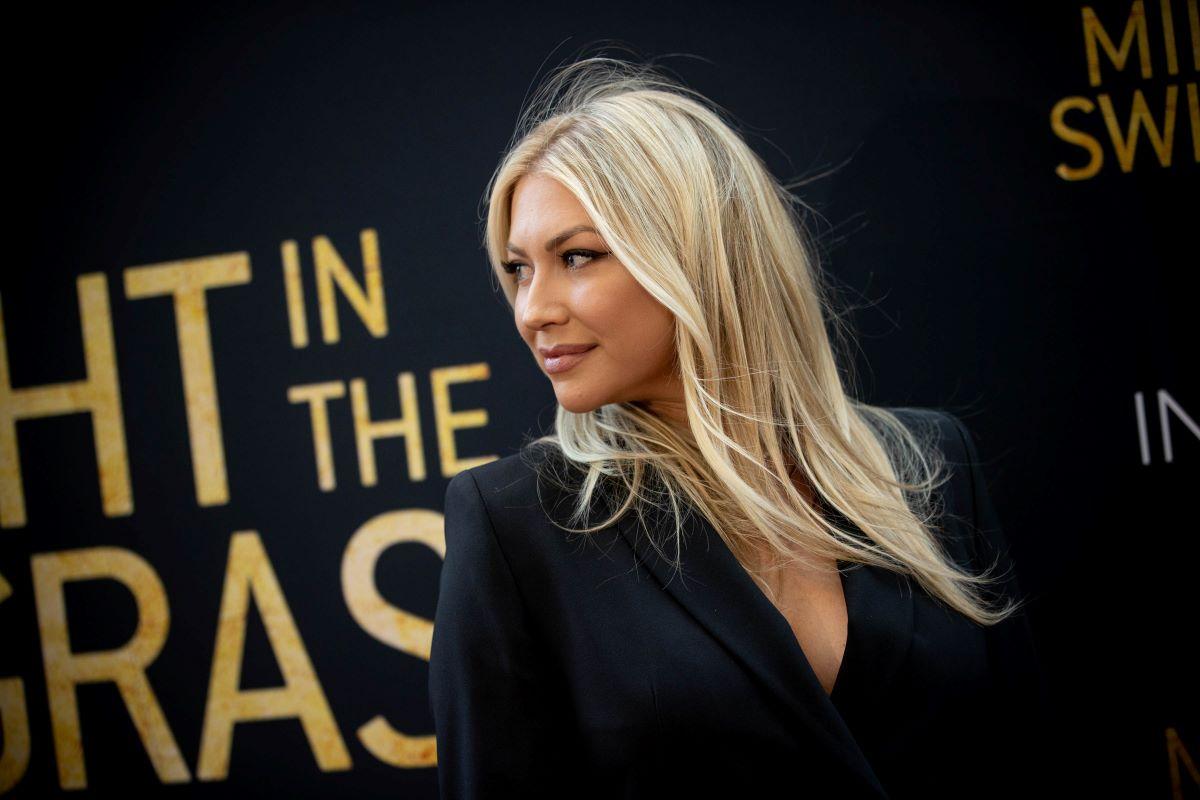 Stassi Schroeder in black at movie premiere.