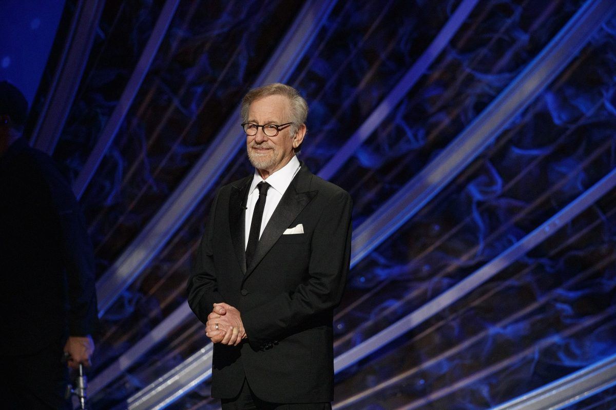Steven Spielberg clasping his hands in front of him on stage.