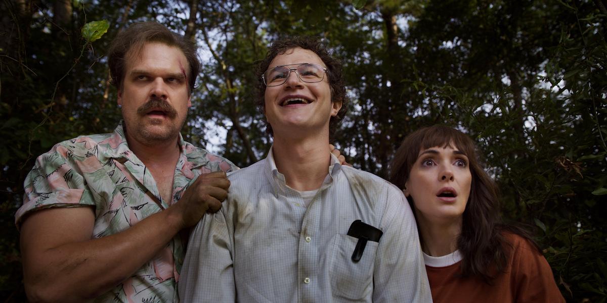 Hopper, Alexei, and Joyce in a still from 'Stranger Things' Season 3