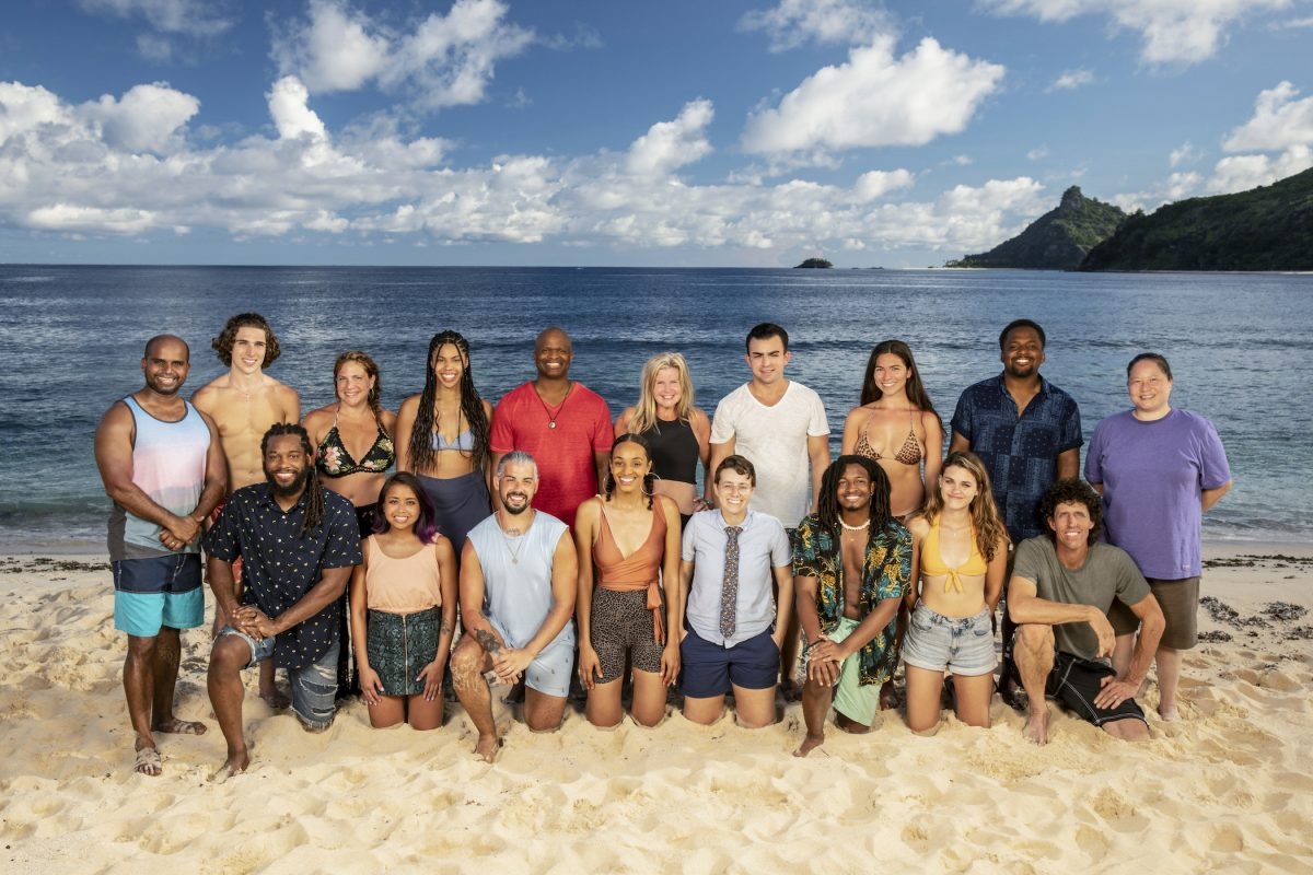 'Survivor' Season 41 cast kneeling on the beach and smiling at the camera