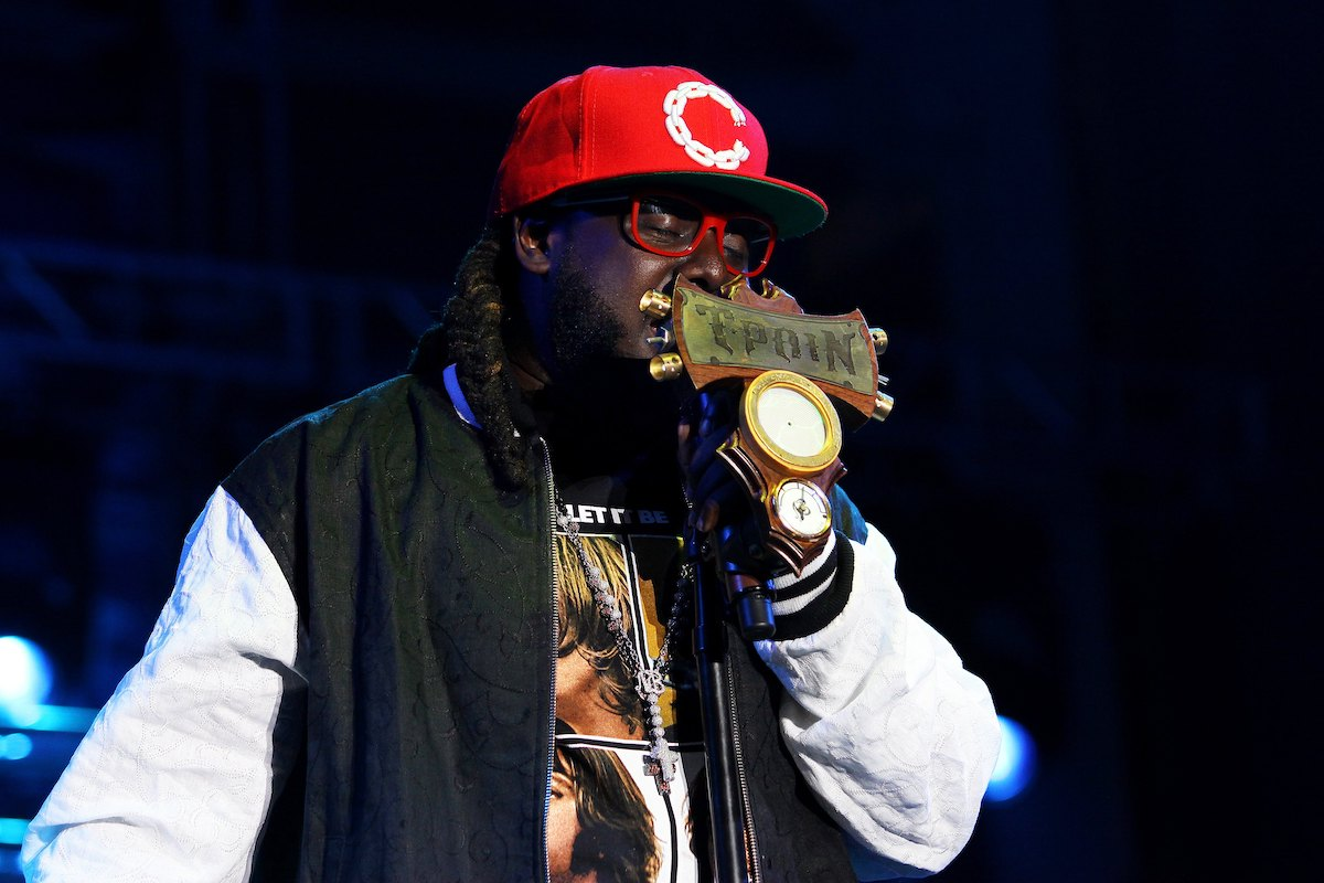 T-Pain wears a black and white jacket and a red hat as he performs during the B96 Pepsi Summerbash at Toyota Park in Bridgeview, Illinois on June 11, 2011.