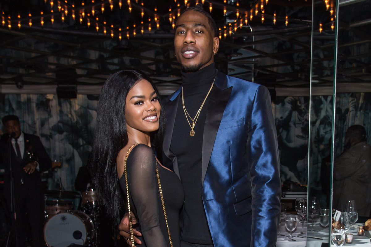 Teyana Taylor and Iman Shumpert pose for photo together at a Forbes dinner party
