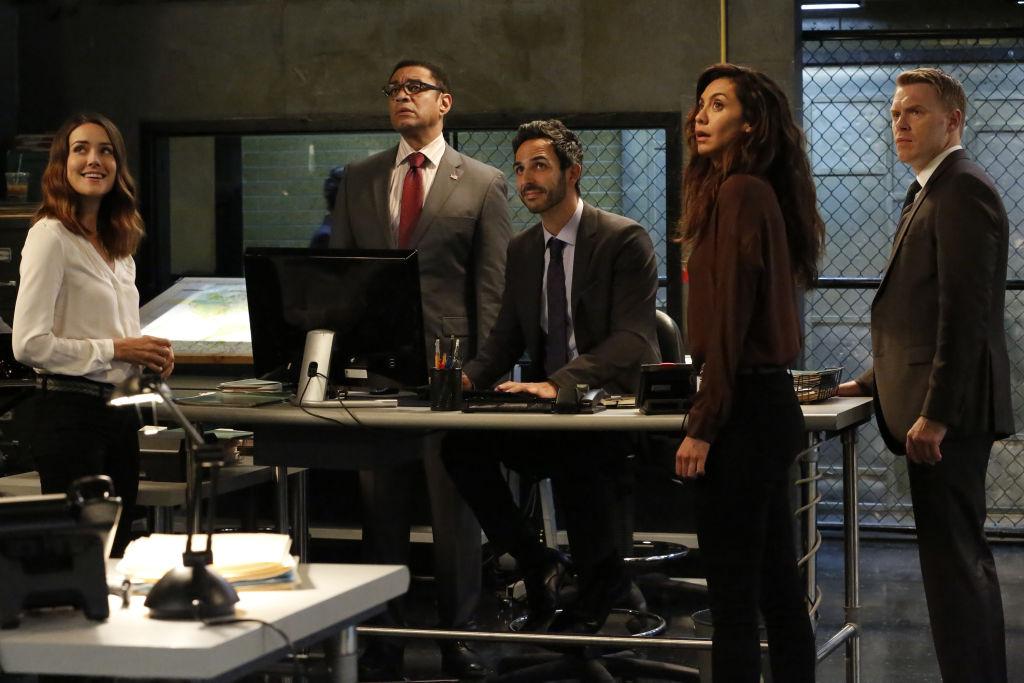 Megan Boone as Elizabeth Keen, Harry Lennix as Harold Cooper, Amir Arison as Aram Mojitabai, Mozhan Marnò as Samar Navabi, Diego Klattenhoff as Donald Ressler stand in the FBI task force headquarters.
