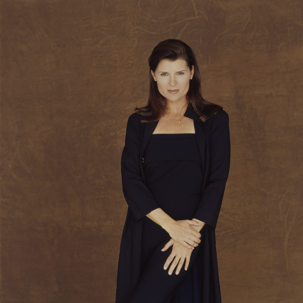 The Bold and the Beautiful spoilers focus on Sheila Carter, pictured here in a blue dress against a brown background