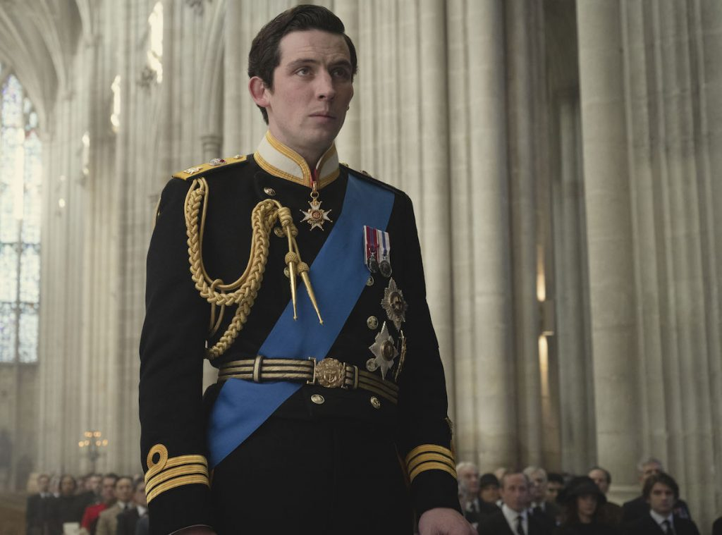 Prince Charles (JOSH O CONNOR) is standing in Winchester Cathedral