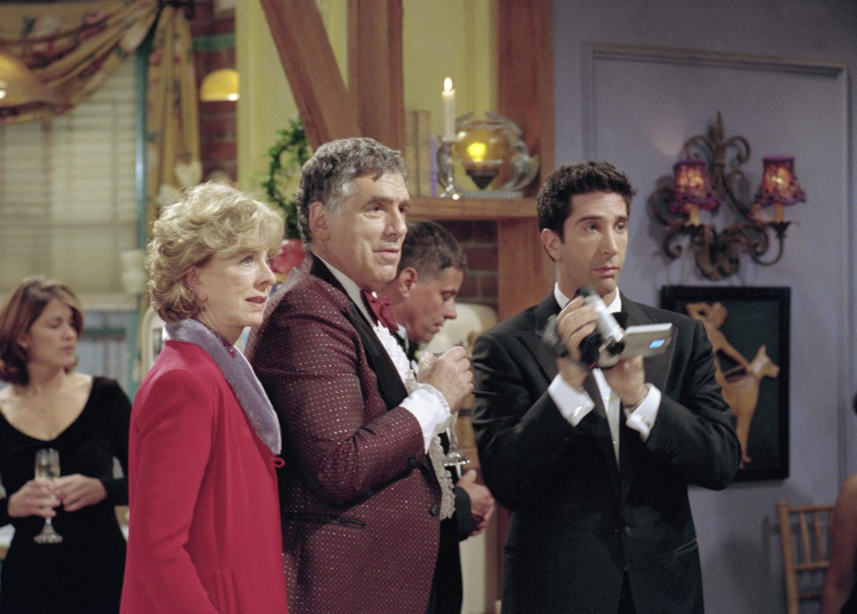 Judy Geller, Jack Geller and Ross Geller stand together in Monica's living room in 'The One Where They All Turn Thirty'