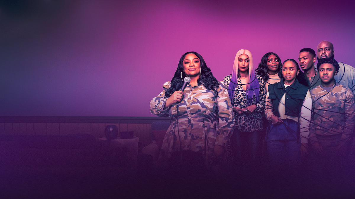 """J. Bernard Calloway, Tami Roman, Vince Swann, Briyana Guadalupe, Theodore Barnes, and Brittany Inge in standing around Patrice """"Ms. Pat"""" Williams as she speaks into a microphone 'The Ms. Pat Show'"""