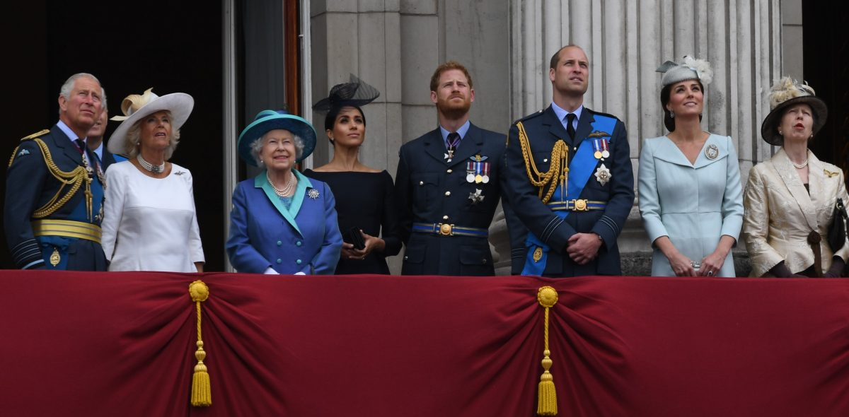 The Royal Family standing on the Buckingham Palace balcony watching a flypast