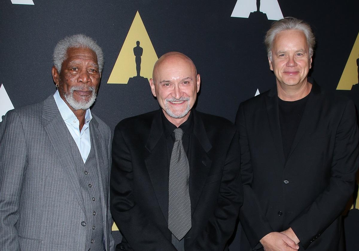 Morgan Freeman, Frank Darabont, and Tim Robbins smile for the camera.