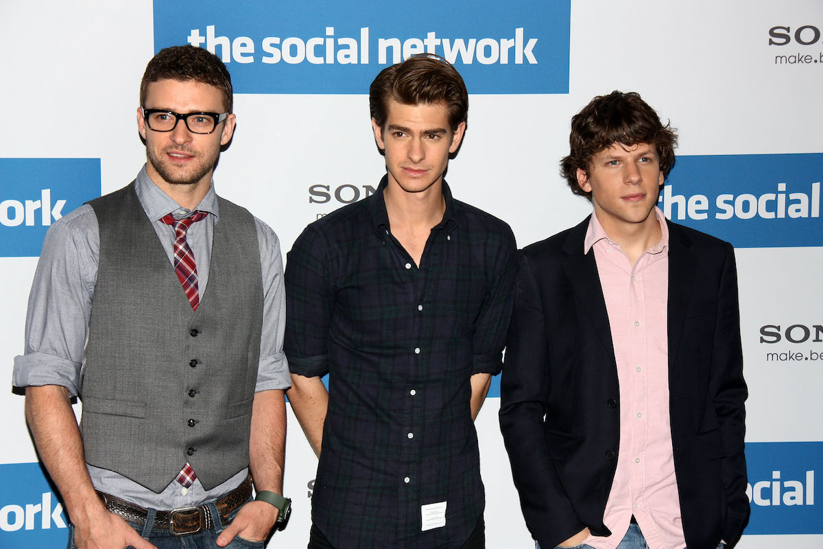 Justin Timberlake, Andrew Garfield, and Jesse Eisenberg attend a photocall to promote the film 'The Social Network' in October 2010. Garfield played Eduardo Saverin in 'The Social Network,' which started filming in October 2009. He recently revealed that he attended a Golden Globes party while filming, but he stayed in character that weekend and it affected his attitude at the event, leading to him getting into an 'altercation' with a couple.
