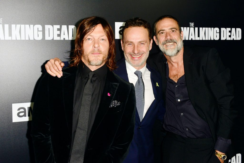 Cast members from 'The Walking Dead' in front of a black background