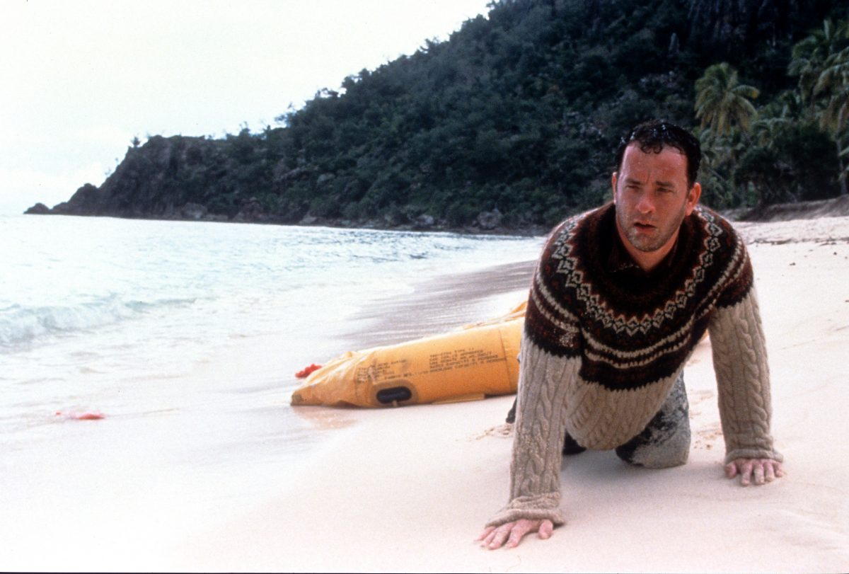 Tom Hanks sits in shock ashore of a remote island in Cast Away
