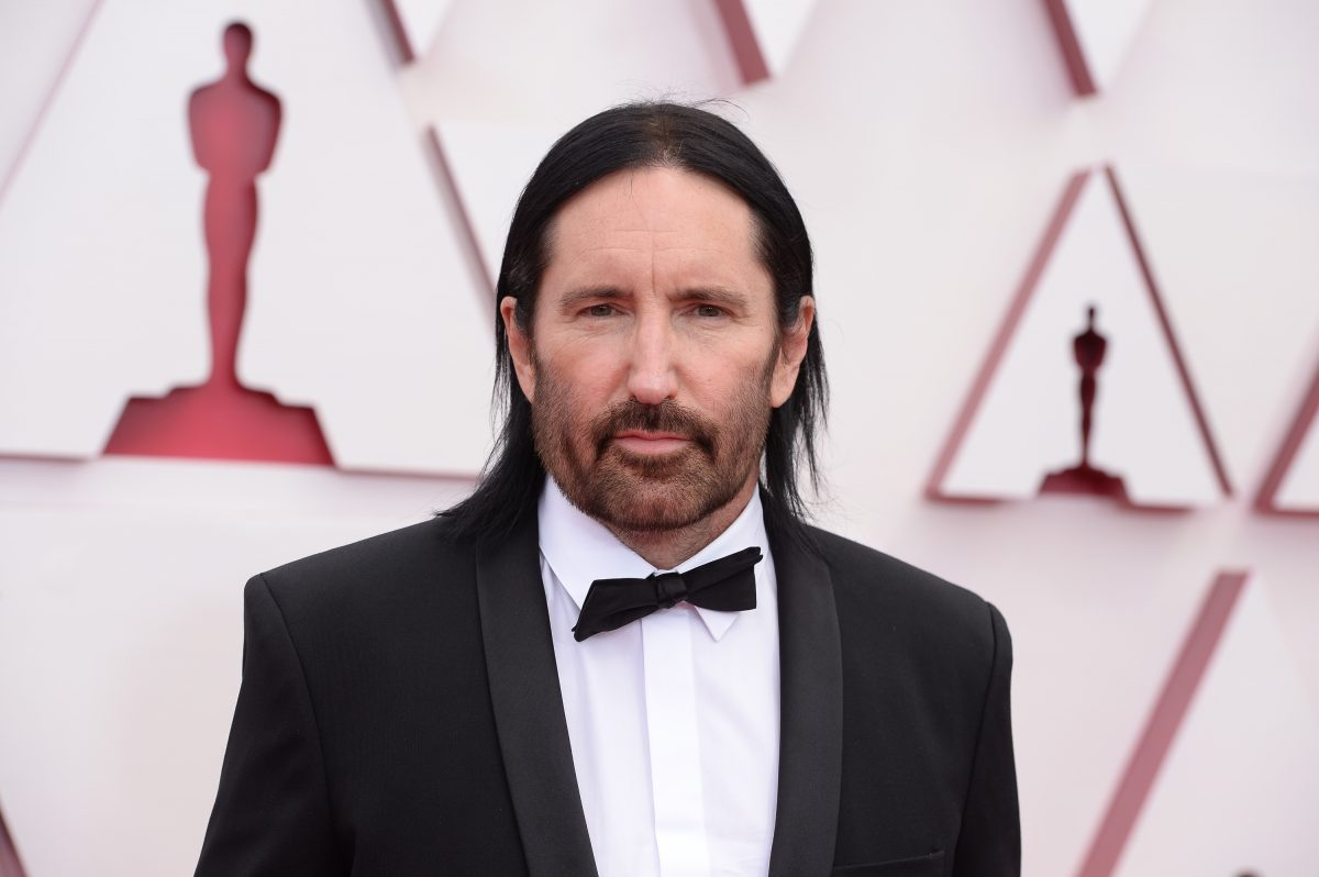 Trent Reznor looks at camera while attending Oscars 2021