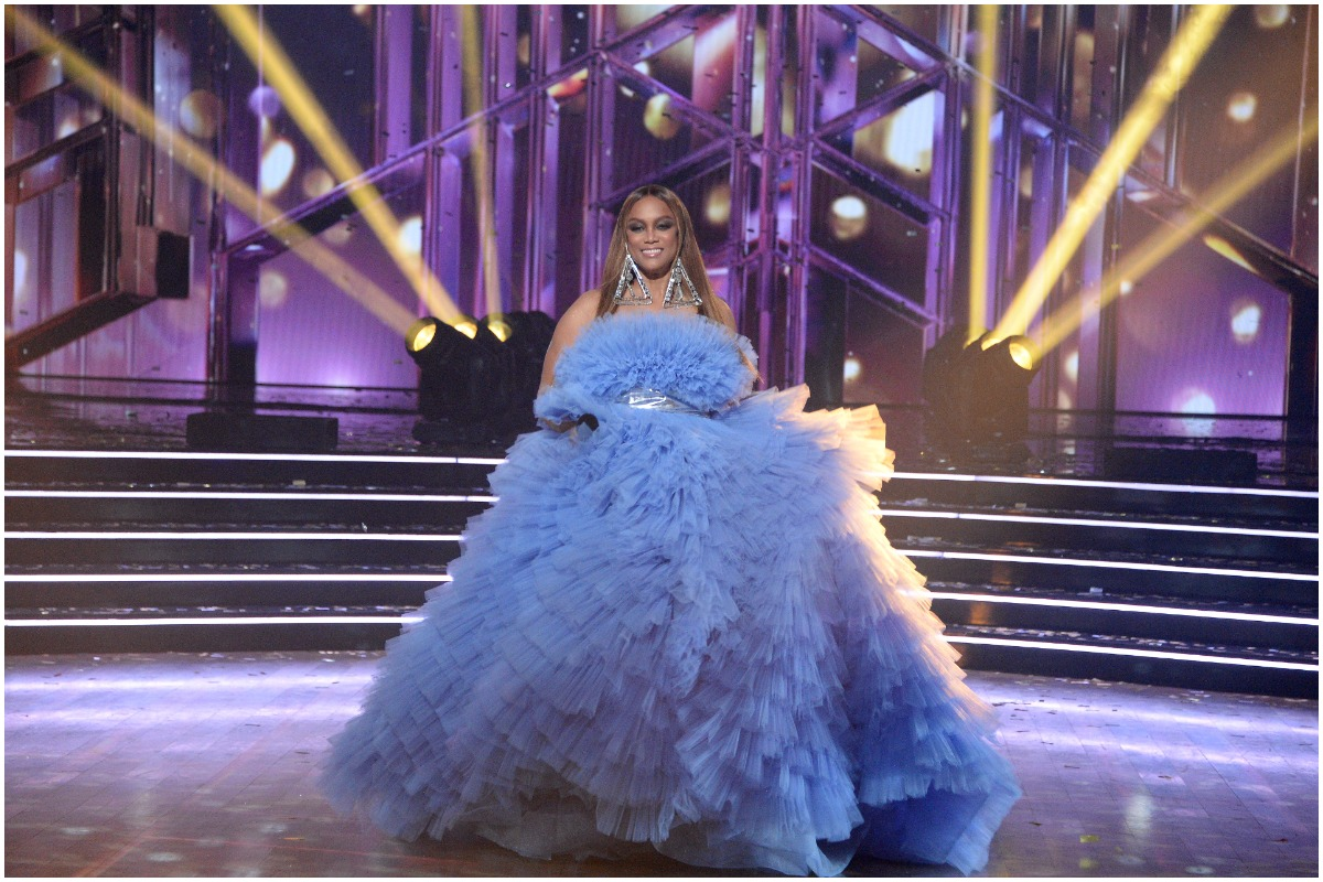 Tyra Banks wearing a blue gown center stage at the 'Dancing With the Stars' finale.