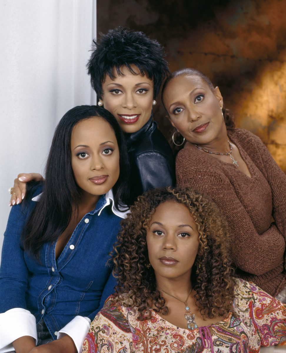 Valarie Pettiford, Telma Hopkins, Rachel True, and Essence Atkins sitting together for a photo shoot for 'Half & Half'