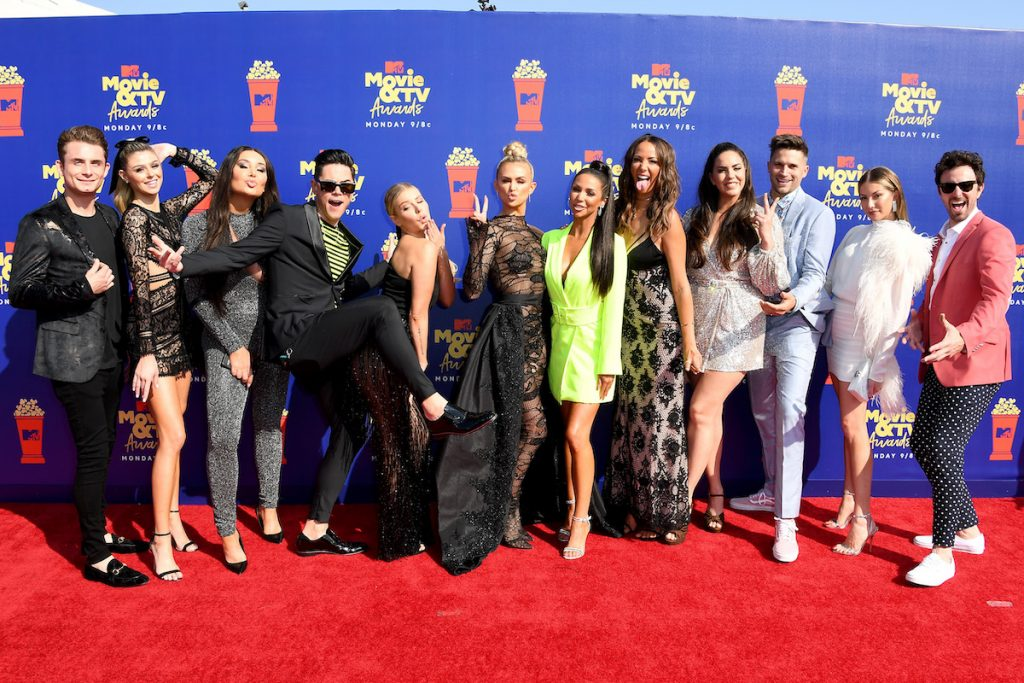 The cast of Vanderpump Rules strikes a silly pose on the red carpet.