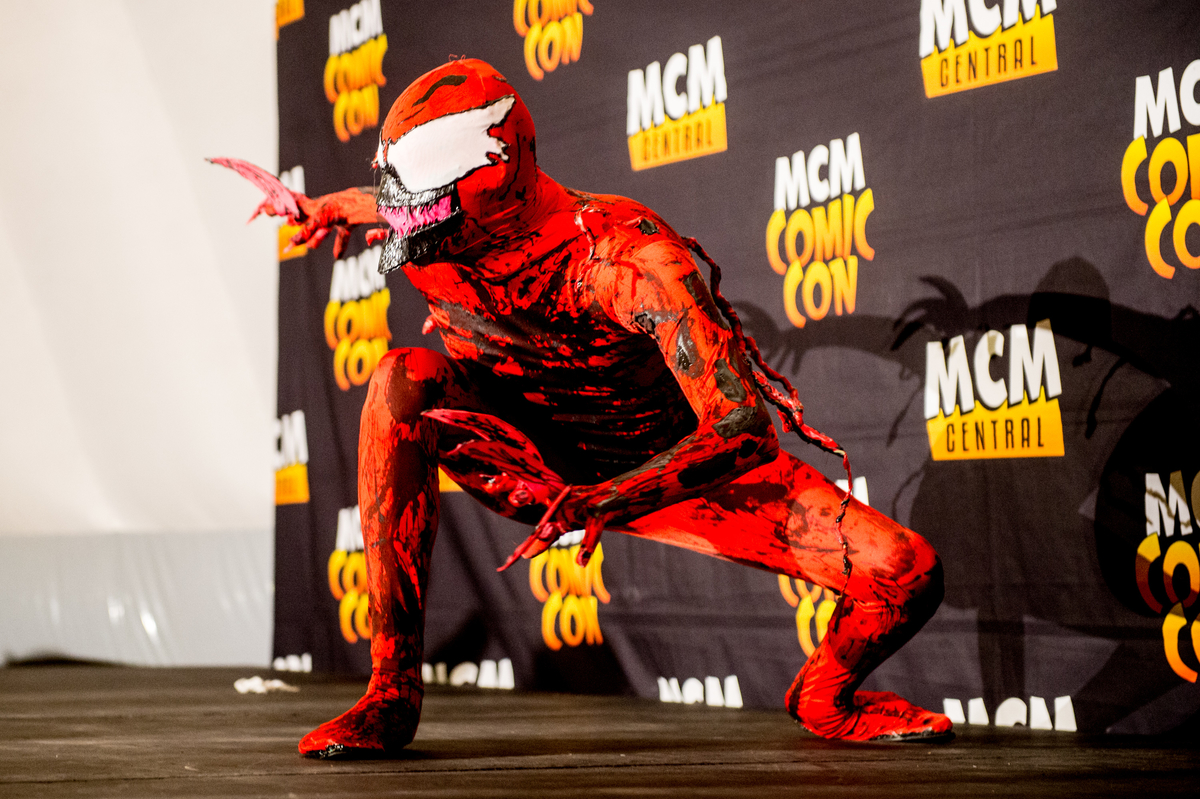 Cosplayer as the symbiote Spider-Man villains Carnage and Cletus Kasady