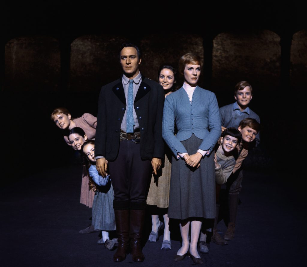 Julie Andrews and Christopher Plummer are flanked on all sides by their children, all members of the singing Von Trapp family, in this publicity handout from the 1965 adaption of the Rodgers and Hammerstein musical, The Sound of Music | Bettmann/Getty Images
