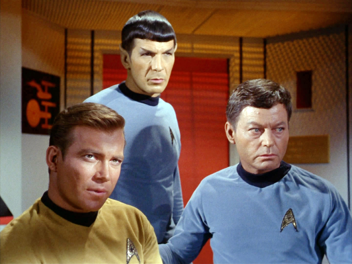 William Shatner as James Kirk, Leonard Nimoy as Spock, and DeForest Kelley as McCoy in 'Star Trek'