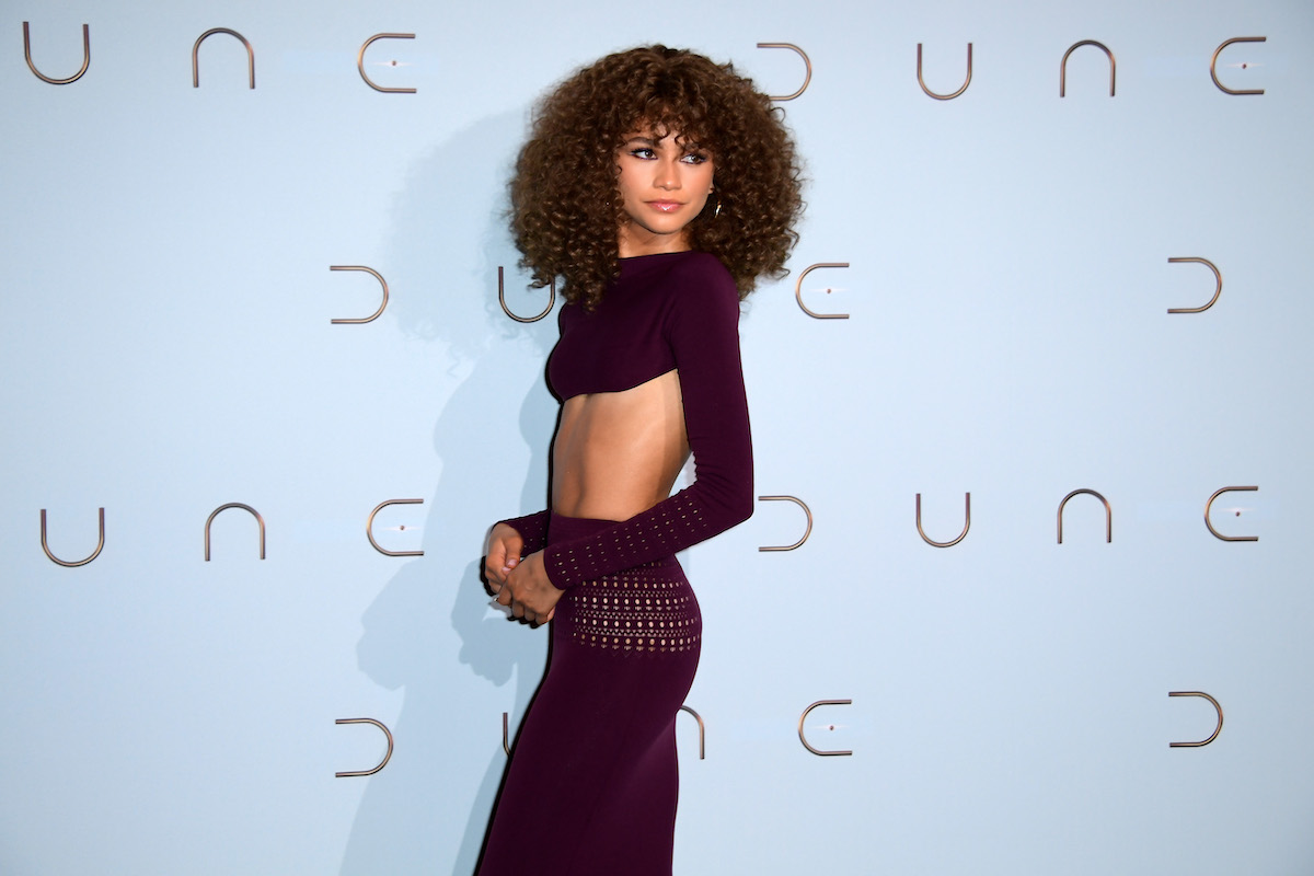 Zendaya attends the photocall for 'Dune' in a purple two piece outfit