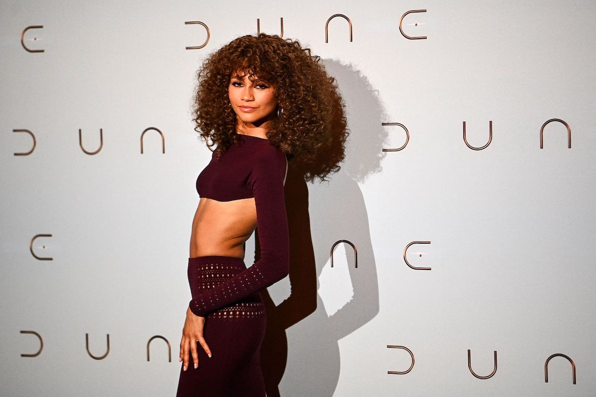 Zendaya poses in a two piece outfit during a photocall for 'Dune'