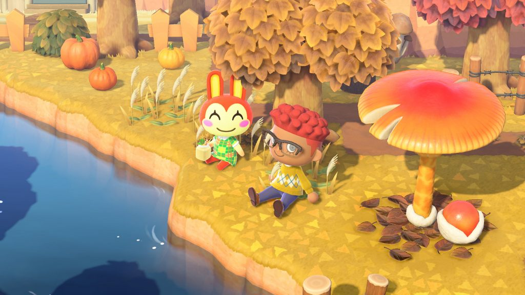 'Animal Crossing: New Horizons' characters sit together in the fall