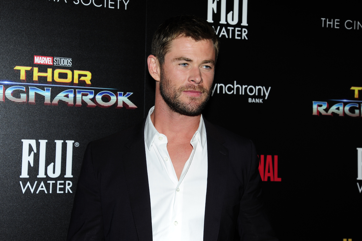 Chris Hemsworth in front of Thor: Ragnarok background