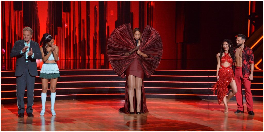 """Tyra Banks stands between competitors and pros on the set of """"Dancing With the Stars."""""""