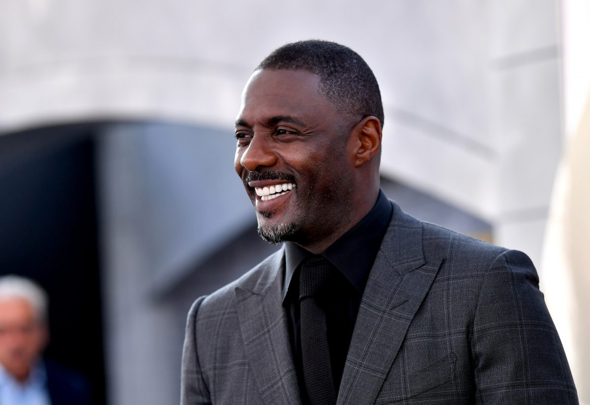 Idris Elba, star of Netflix They Harder They Fall movie, flashes a smiles